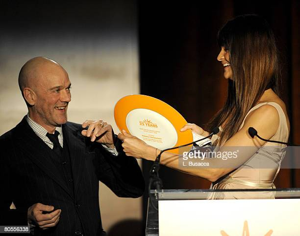 Musician Michael Stipe of REM and model Helena Christensen on stage during the Food Bank For New York City's 5th Annual CanDo Awards Dinner at...