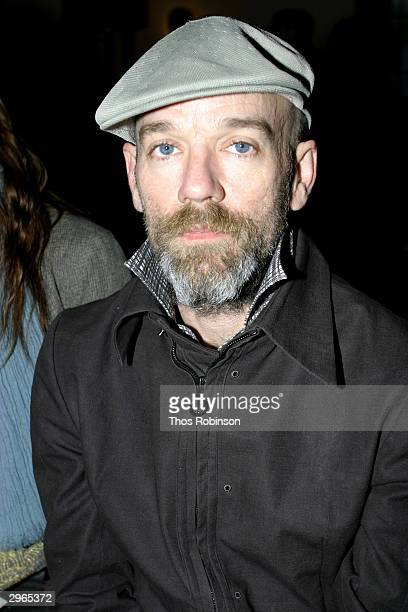 Musician Michael Stipe sits front row at the Libertine fashion show at St. Barts Park Ave during the Olympus Fall Fashion Week February 10, 2004 in...