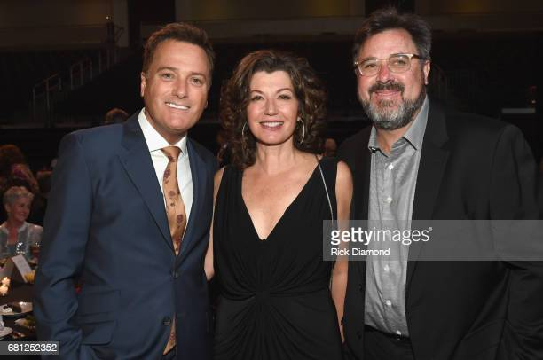 Musician Michael W Smith singersongwriter Amy Grant and singersongwriter Vince Gill take photos at the GMA Honors on May 9 2017 in Nashville Tennessee
