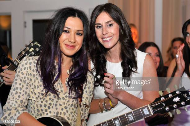 """Musician Michelle Branch and President of Rock the Vote Ashley Spillane pose at the Seventh Annual OFF THE RECORD Event Celebrating """"Women In News..."""