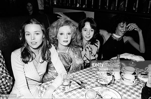 Musician Michelle Phillips and her former stepdaughter actress Mackenzie Phillips sit on either side of actress Genevieve Waite as they attend the...
