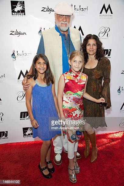 Musician Mick Fleetwood and wife Lynn Frankel with daughters Tessa and Ruby attend his Opening Reception For 'Rythym Of A Rose' Art Exhibition At The...