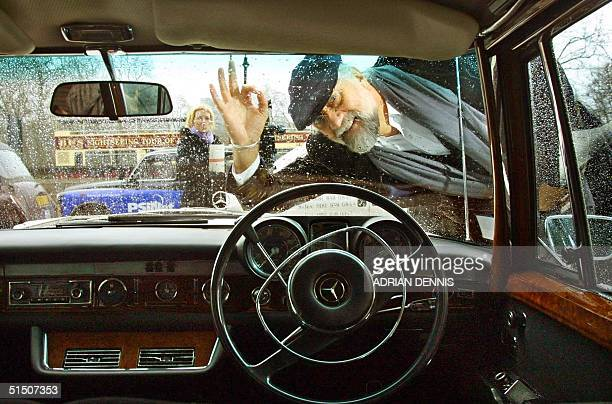 Musician Mick Fleetwood of Fleetwood Mac fame peers through the windscreen of Mercedes Benz 600 limousine formerly owned by John Lennon at The Hard...