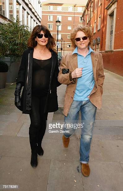 Musician Mick Hucknall and girlfriend Gabriella Wesberry walk in Covent Garden on February 1 2007 in London The couple announced today that they are...