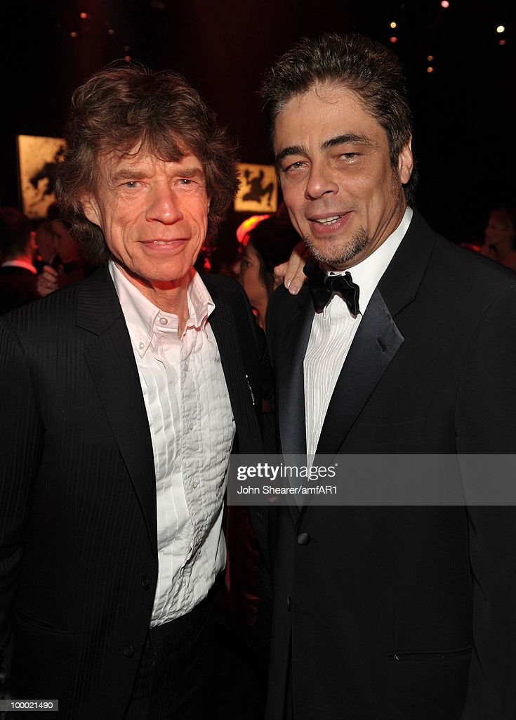 Musician Mick Jagger and actor Benicio Del Toro attend amfAR's Cinema Against AIDS 2010 benefit gala dinner at the Hotel du Cap on May 20, 2010 in Antibes, France.