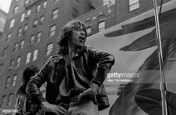 Musician Mick Jagger and the Rolling Stones promote their 'Tour of The Americas' by playing 'Brown Sugar' on a flatbed truck in Greenwich Village New...