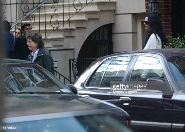 Musician Mick Jagger leaves the Amaranth restaurant with girlfriend L'Wren Scott October 4 2004 in New York City
