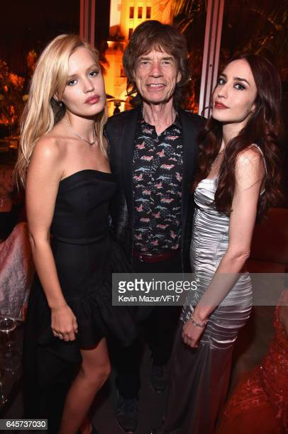 Musician Mick Jagger with models Georgia May Jagger and Elizabeth Jagger attend the 2017 Vanity Fair Oscar Party hosted by Graydon Carter at Wallis...