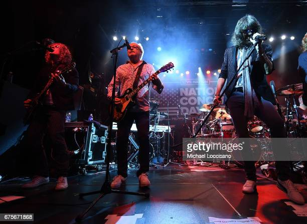 Musician Mick Jones and Singer Kelly Hansen of Foreigner perform during Live Nation's celebration of The 3rd Annual National Concert Day at Irving...