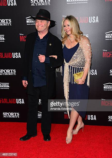 Musician Micky Dolenz and Donna Quinter arrive at the world premiere of Disney's McFarland USA at the El Capitan Theatre on February 9 2015 in...
