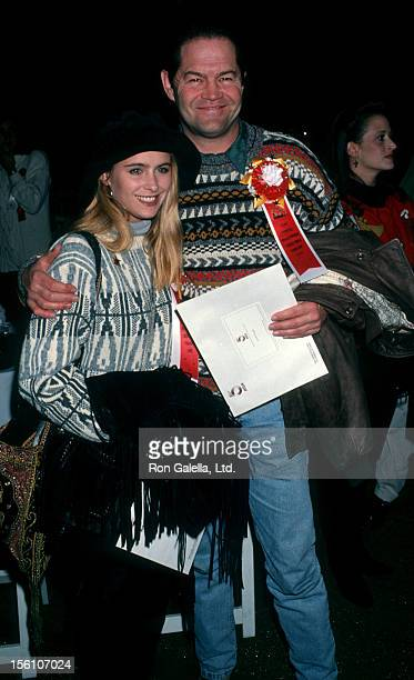 Musician Micky Dolenz of The Monkees and daughter actress Ami Dolenz attend 'Hollywood Christmas Parade' on November 28 1993 in Hollywood California