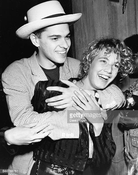 Musician Migi Drummond of band 'Curiosity Killed the Cat' joking around with actress Emily Lloyd at a party in honor of Whitney Houston London May...