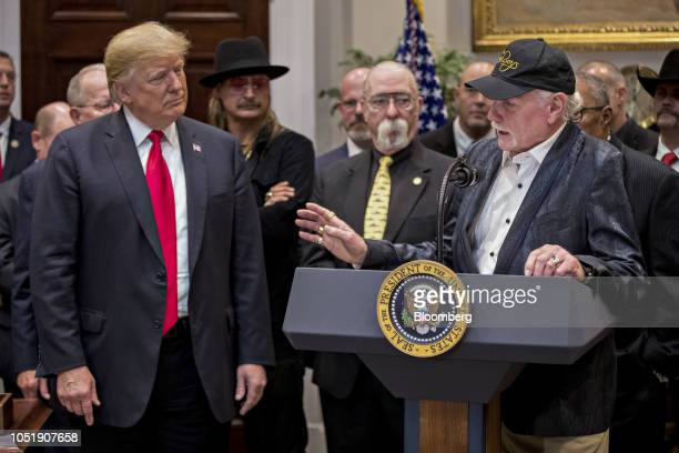 Musician Mike Love right speaks as US President Donald Trump left listens during a signing ceremony for HR 1551 the HatchGoodlatte Music...