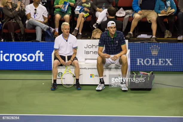 Musician Mike McCready and John Isner of the United States take a break at the Match For Africa 4 exhibition match at KeyArena on April 29, 2017 in...
