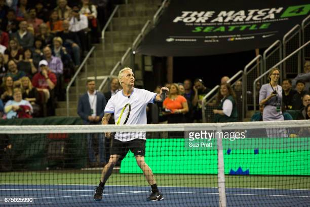 Musician Mike McCready in action against Bill Gates and Roger Federer at the Match For Africa 4 exhibition match at KeyArena on April 29, 2017 in...