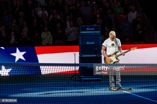 Musician Mike McCready plays the United States national anthem at the Match For Africa 4 exhibition match at KeyArena on April 29, 2017 in Seattle,...