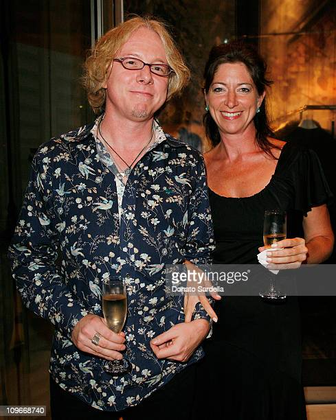 Musician Mike Mills from REM and guest attends the Maison Martin Margiela Store Opening on September 5 2007 in Beverly Hills California