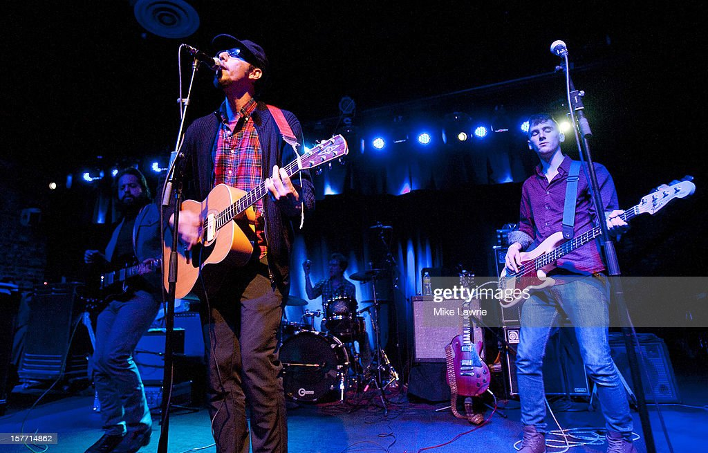 Musician Mike Montali (C) of Hollis Brown performs at Brooklyn Bowl on December 5, 2012 in New York City.