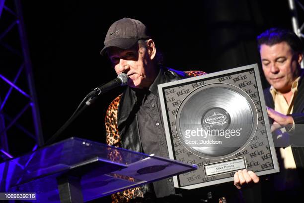 Musician Mike Pinera former member of Blues Image and Iron Butterfly receives an award during the Rock Godz Hall of Fame Awards Show and Benefit at...