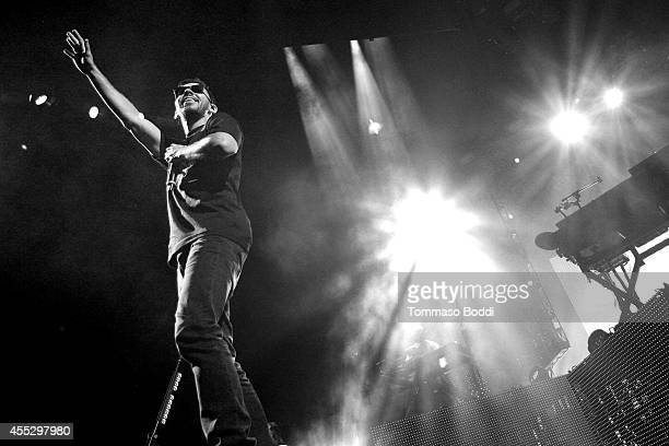 Musician Mike Shinoda of Linkin Park performs during 'The Carnivores Tour' at Verizon Wireless Amphitheater on September 11 2014 in Irvine California