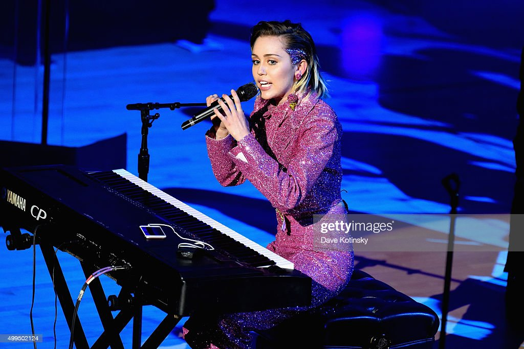 Musician Miley Cyrus performs on stage at the ONE Campaign and (RED)'s concert to mark World AIDS Day, celebrate the incredible progress that's been made in the fights against extreme poverty and HIV/AIDS, and to honor the extraordinary leaders, dedicated activists, and passionate partners who have made that progress possible. At Carnegie Hall on December 1, 2015 in New York City.