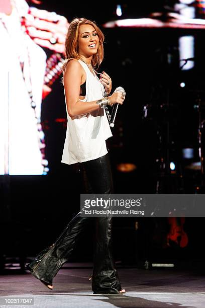 Musician Miley Cyrus performs onstage at Nashville Rising, a benefit concert for flood relief at Bridgestone Arena on June 22, 2010 in Nashville,...