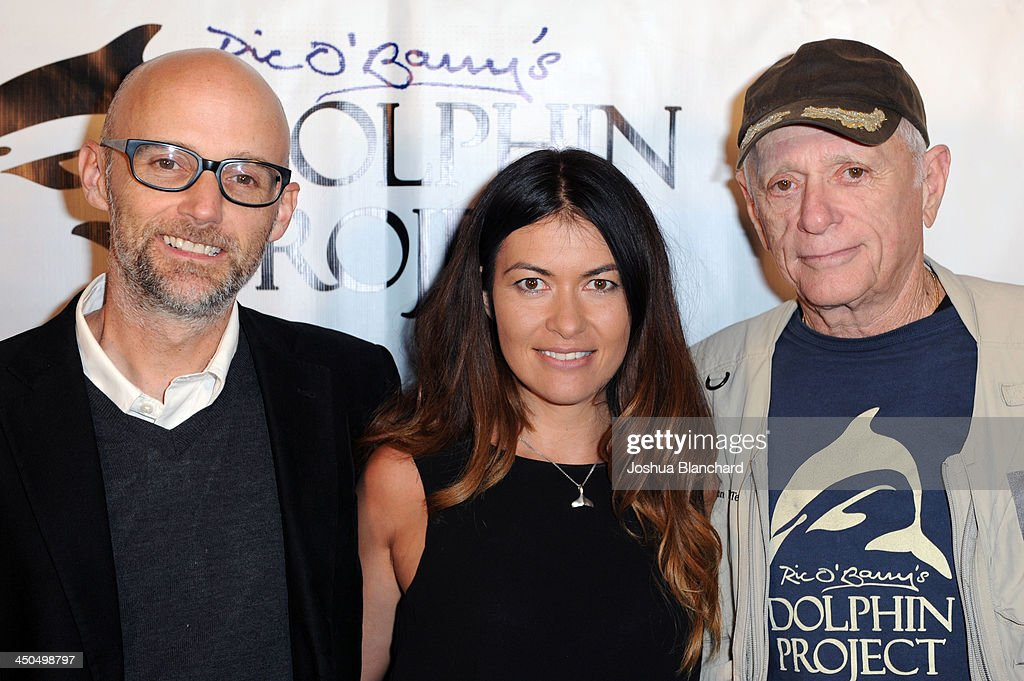 Musician Moby, Racecar driver Leilani Munter and Activist Ric O'Barry arrive at the Avalon for Kings of Chaos Tokyo Celebrates The Dolphin Benefit Concert on November 18, 2013 in Hollywood, California.
