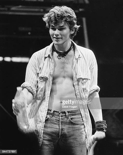 Musician Morten Harket lead singer with pop band 'AHa' holding a water bottle as he performs on stage December 9th 1986