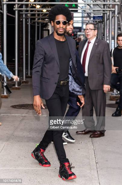 Musician multiinstrumentalist and bandleader Jon Batiste is seen leaving 'The Late Show With Stephen Colbert' at the Ed Sullivan Theater on August 15...