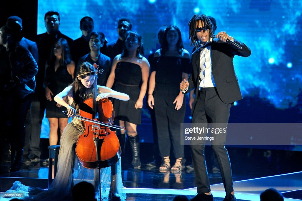 Musician Nana Ou-Yang (L) and rapper Wiz Khalifa perform onstage during the 2018 Breakthrough Prize at NASA Ames Research Center on December 3, 2017 in Mountain View, California.