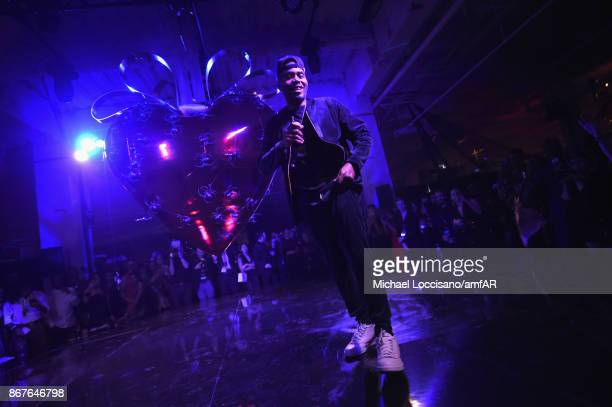 Musician Nas performs onstage at the 2017 amfAR The Naked Heart Foundation Fabulous Fund Fair at Skylight Clarkson Sq on October 28 2017 in New York...