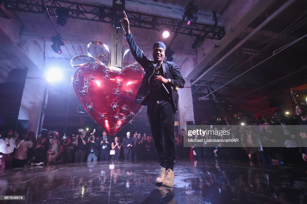 Musician Nas performs onstage at the 2017 amfAR & The Naked Heart Foundation Fabulous Fund Fair at Skylight Clarkson Sq on October 28, 2017 in New York City.