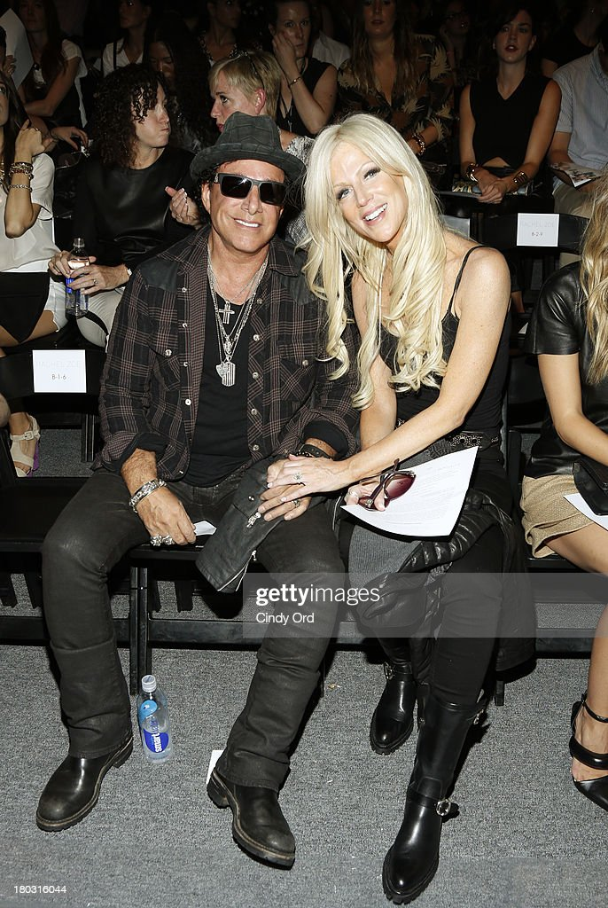 Musician Neal Schon (L) and Michaele Salahi attend the Rachel Zoe fashion show during Mercedes-Benz Fashion Week Spring 2014 at The Studio at Lincoln Center on September 11, 2013 in New York City.