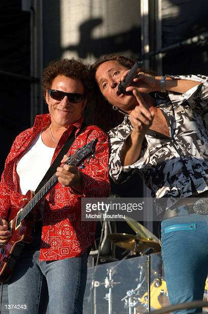 Musician Neal Schon and singer Steve Augeri from the Rock Band Journey perform at the Harley Davidson 100th Anniversary September 8 2002 in Fontana...