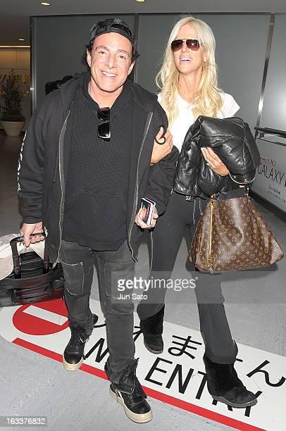 Musician Neal Schon of Journey and Michaele Salahi arrive at Narita International airport on March 9 2013 in Narita Japan