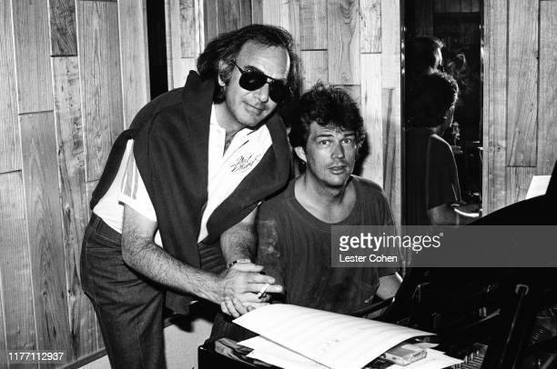 Musician Neil Diamond and producer David Foster at the piano in the studio in circa 1986 in Los Angeles, California.