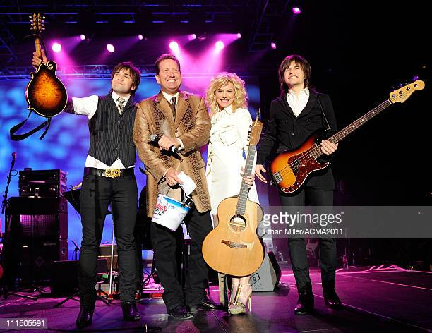 Musician Neil Perry host Shawn Parr and musicians Kimberly Perry and Reid Perry of The Band Perry onstage during the Academy of Country Music Awards...