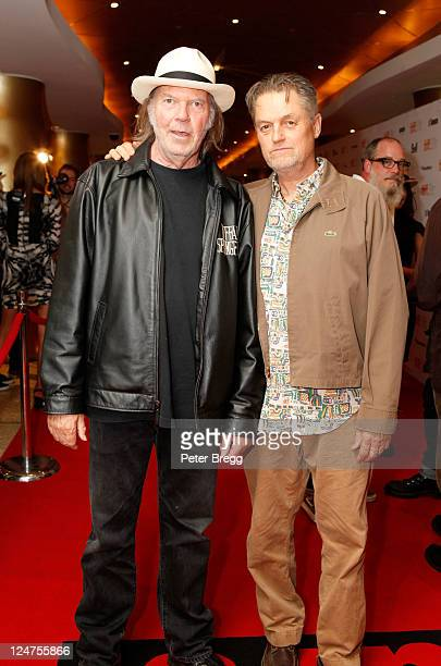 Musician Neil Young and director Jonathan Demme attend 'Neil Young Life' Premiere at Princess of Wales during the 2011 Toronto International Film...