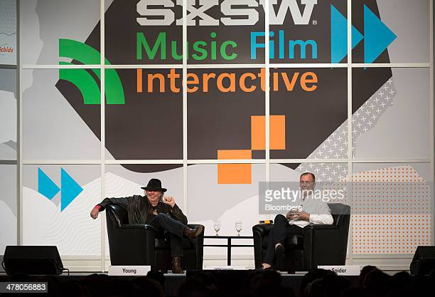 Musician Neil Young founder and chairman of PonoMusic left and Jon Hamm chief executive officer listen to a question from the audience during a...