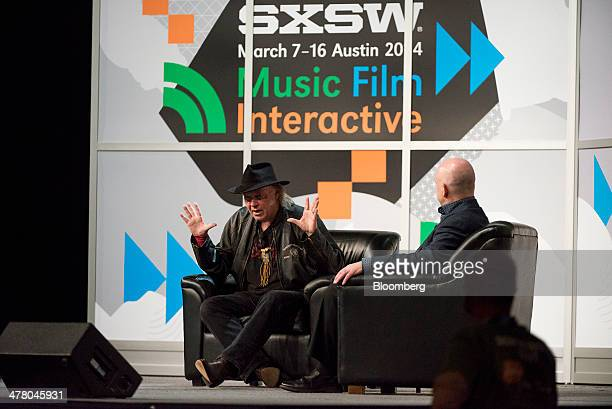 Musician Neil Young founder and chairman of PonoMusic left speaks during a featured session at the South By Southwest Interactive Festival in Austin...