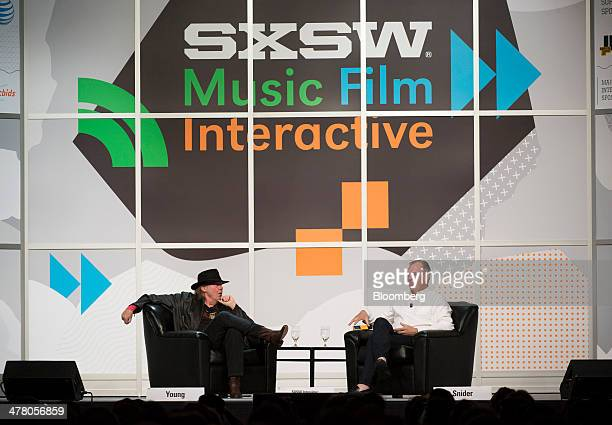 Musician Neil Young founder and chairman of PonoMusic left speaks as Jon Hamm chief executive officer listens during a featured session at the South...