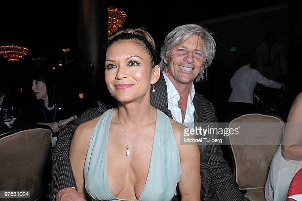 Musician Nia Peeples attends the 11th Annual Children Uniting Nations Oscar Celebration with husband Sam George held at the Beverly Hilton Hotel on...