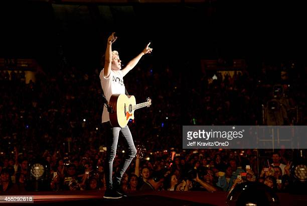 Musician Niall Horan of One Direction performs onstage during the One Direction Where We Are Tour at Rose Bowl on September 11 2014 in Pasadena...