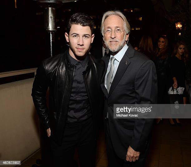 Musician Nick Jonas and National Academy of Recording Arts and Sciences President Neil Portnow attend the Billboard Power 100 Event on February 5...