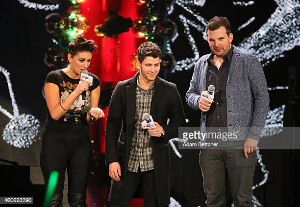 Musician Nick Jonas speaks onstage with Kiss FM personalities Angi Taylor and Christopher Frederick during 1035 KISS FM's Jingle Ball 2014 at...