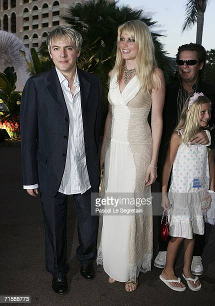 Musician Nick Rhodes of Duran Duran Meredith Ostrom and musician Andy Taylor of Duran Duran with his daughter arrive at the Monaco Red Cross Ball...