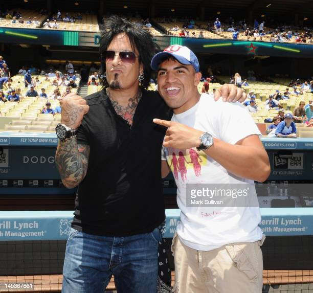 Musician Nikki Sixx and boxer 'Vicious' Victor Ortiz before throwing out the ceremonial first pitch at Dodger Stadium on May 27 2012 in Los Angeles...