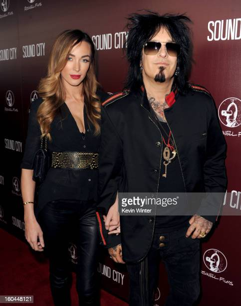 Musician Nikki Sixx and Courtney Bingham arrive at the premiere of Sound City at ArcLight Cinemas Cinerama Dome on January 31 2013 in Hollywood...
