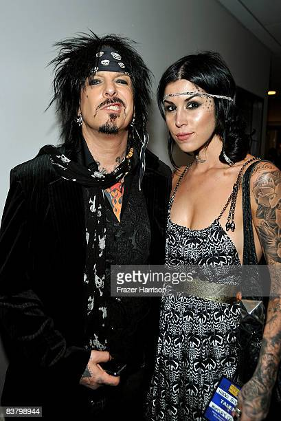Musician Nikki Sixx and Kat Von D pose backstage at the 2008 American Music Awards held at Nokia Theatre LA LIVE on November 23 2008 in Los Angeles...