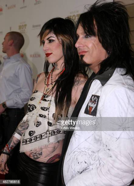 Musician Nikki Sixx and TV personality Kat Von D arrive to Maxim's 2008 Hot 100 Party at Paramount Studios on May 21 2008 in Los Angeles California